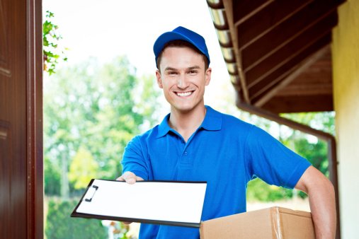Courier Delivering Package Stock Photo - Download Image Now