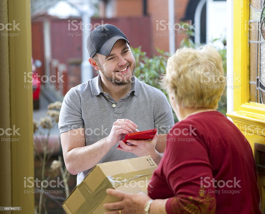 Courier delivering package to gran royalty-free stock photo
