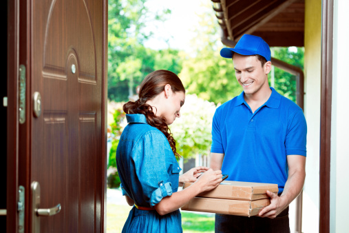 Courier Delivering Packages Stock Photo - Download Image Now