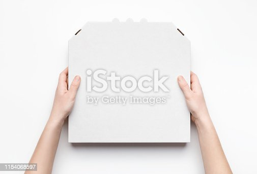 Courier holding pizza box in hands isolated on white background, top view