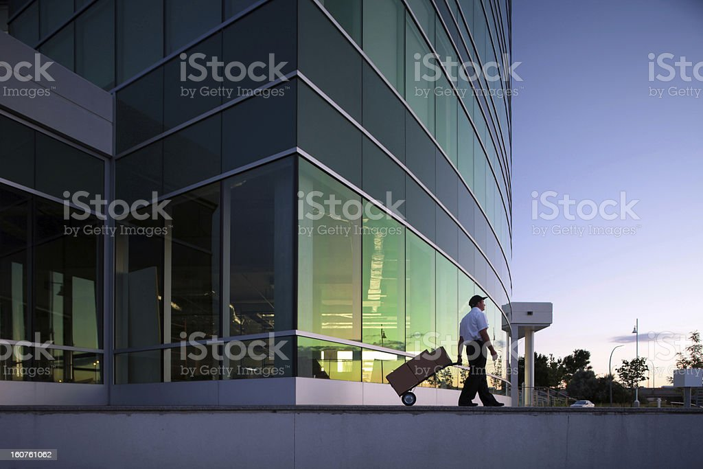 courrier moving boxes from outdoors office stock photo