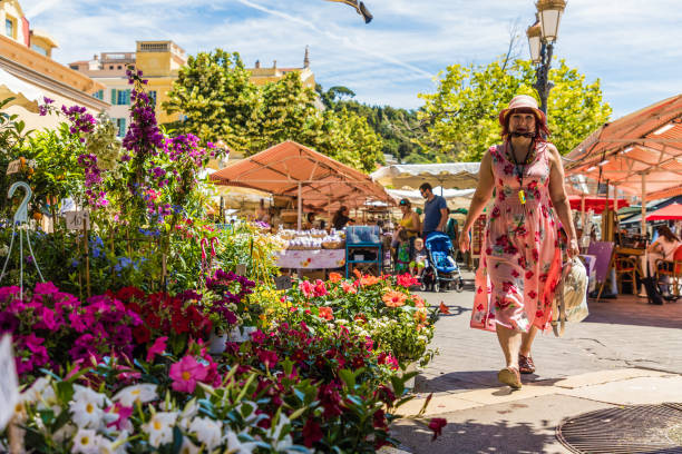Cours Saleya market in Nice France Nice France. June 12 2019. Flower stalls at Cours Saleya market in Nice France ville stock pictures, royalty-free photos & images
