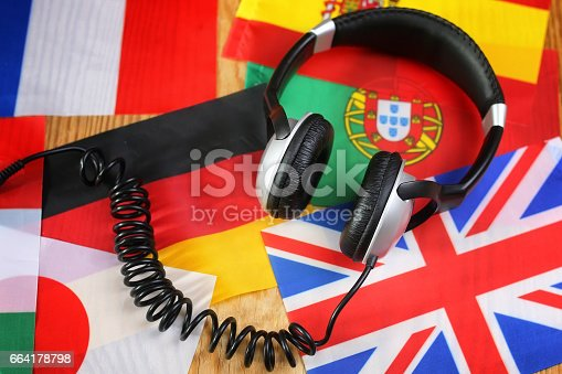 istock course language headphone and flag on a table 664178798