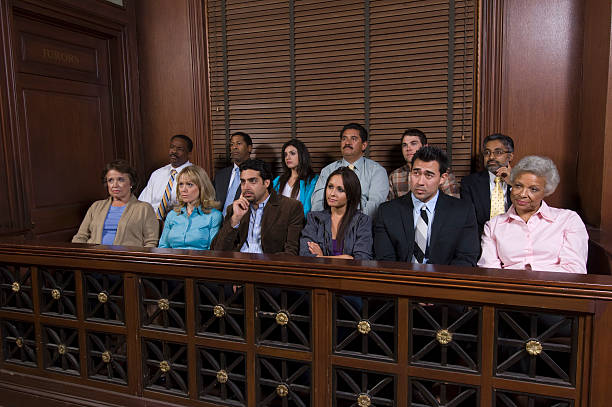 Court room jury box filled with jurors stock photo