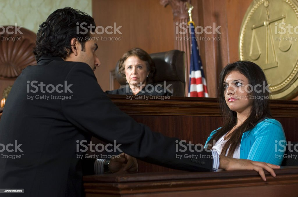 Court setting with judge and person being interrogated stock photo