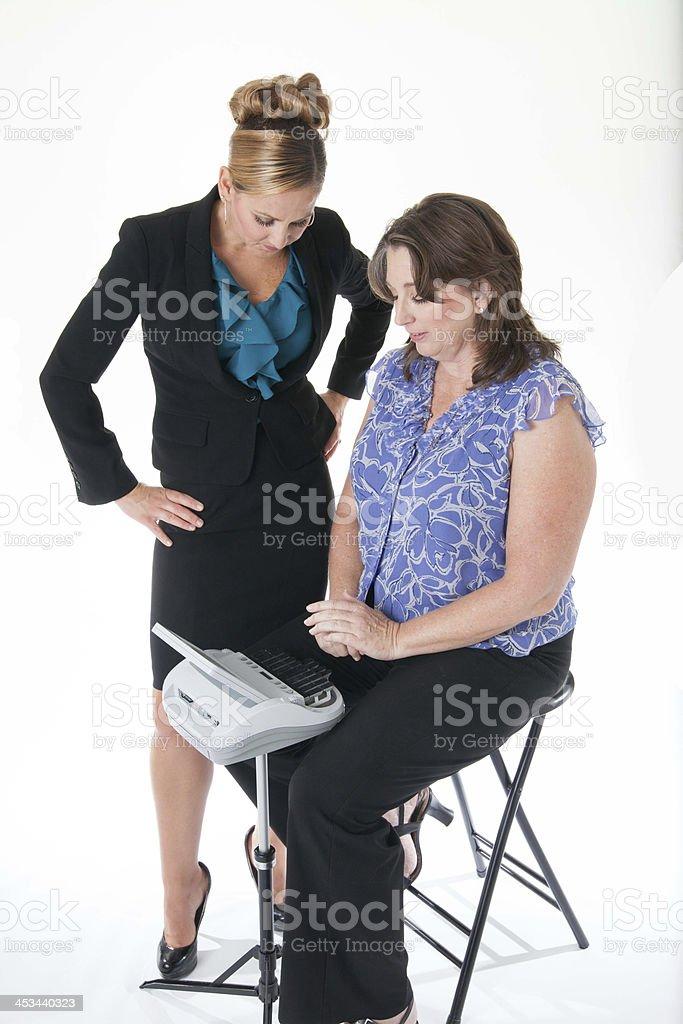 Court stenographer reading back testimony to attorney stock photo