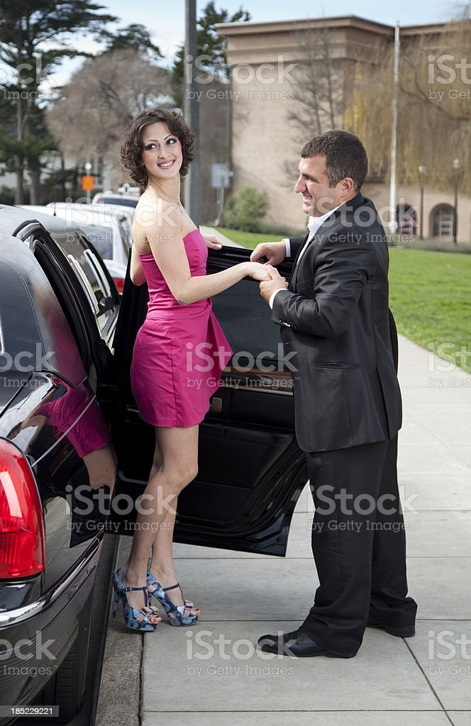 Courteous: Man Helps Woman Exit Limousine royalty-free stock photo