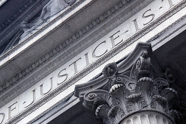 Courthouse close with Justice inscribed stock photo