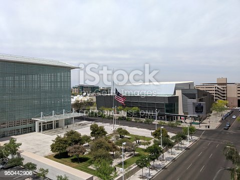 PHOENIX, AZ, USA - APRIL 19, 2018: Sandra Day O'Connor United States Courthouse flying American Flag at Half-Staff in Phoenix downtown, AZ