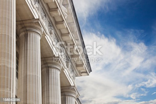 A close up look at a courthouse or government building with lots of copy space to the right