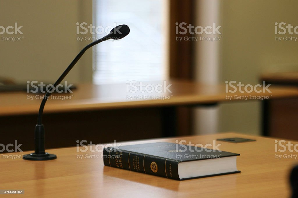 Courtroom Bible and Microphone stock photo