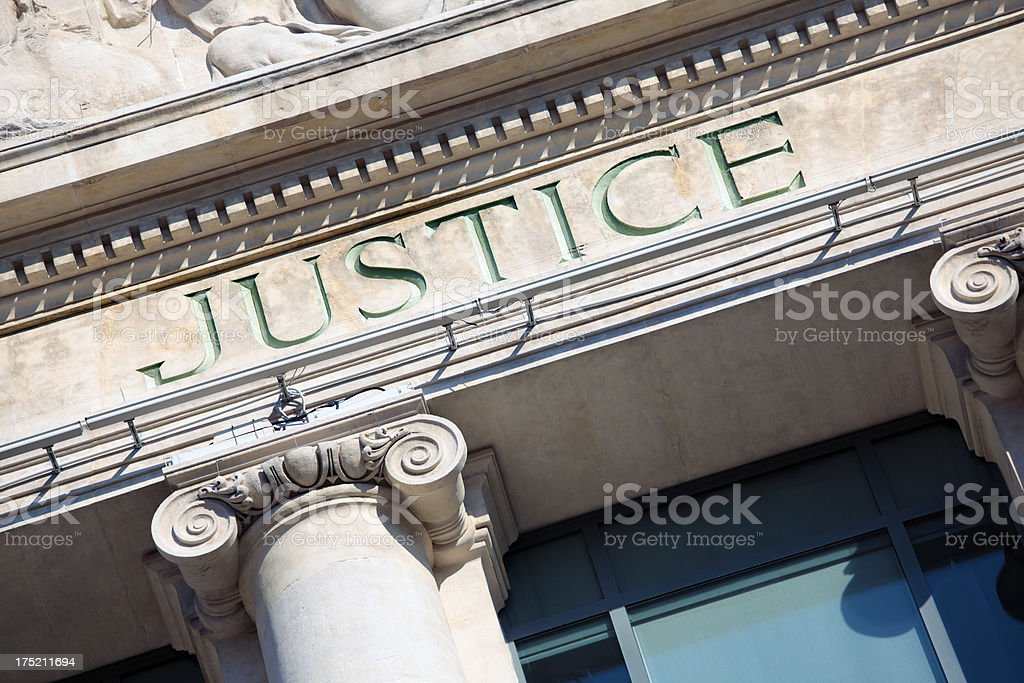 Courtroom building with the word justice royalty-free stock photo