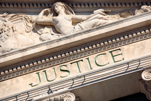 The word Justice on a Courtroom Building.  Photo taken in late afternoon directional light.  Alternative version shown below: