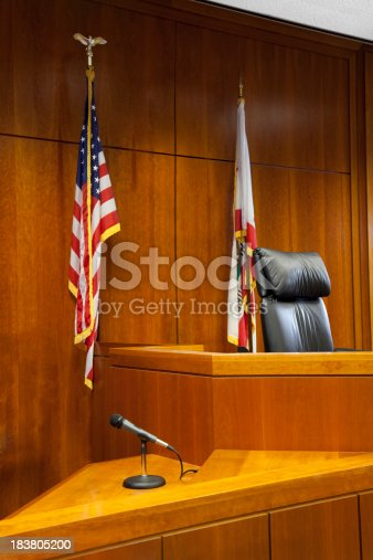 A witness stand and bench in an American courtroom.