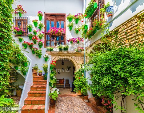 Cordoba, Spain - May 11, 2016: Traditional house and courts with flower in Cordoba, Spain