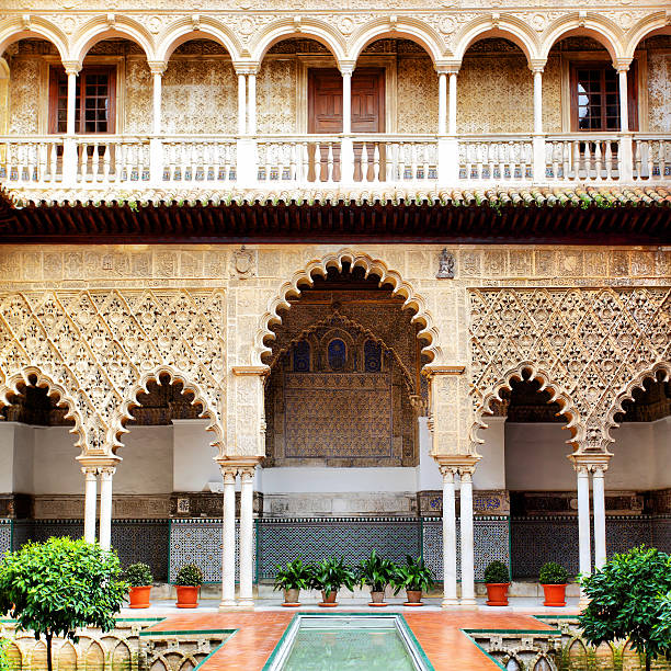 Courtyard in Alcazar Courtyard in Alcazar, Seville, Spain alcazar palace stock pictures, royalty-free photos & images