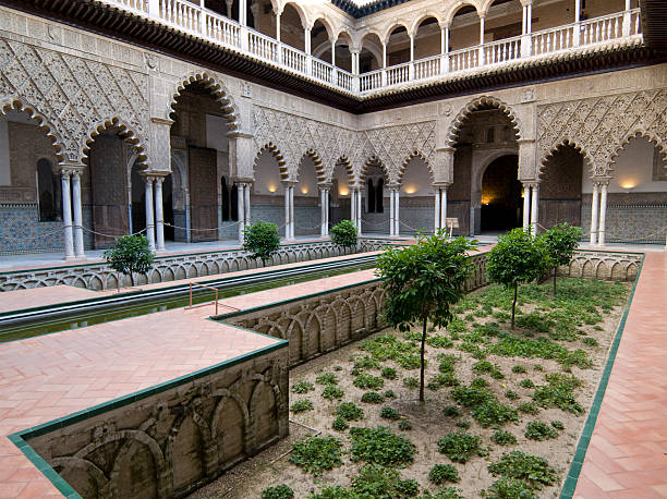 Courtyard in the Alcazar Palace, Seville A courtyard in the Alcazar Palace in Seville, Spain alcazar palace stock pictures, royalty-free photos & images
