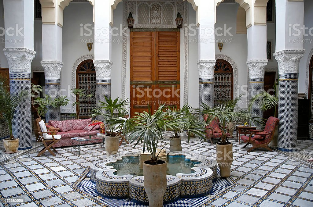 \'Courtyard in old riad in Fez, Morocco with fountain\'