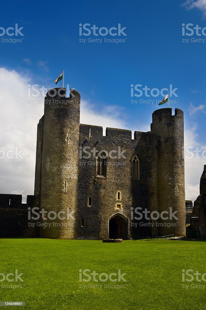 Courtyard of Caerphilly Castle with Welsh flags royalty-free stock photo