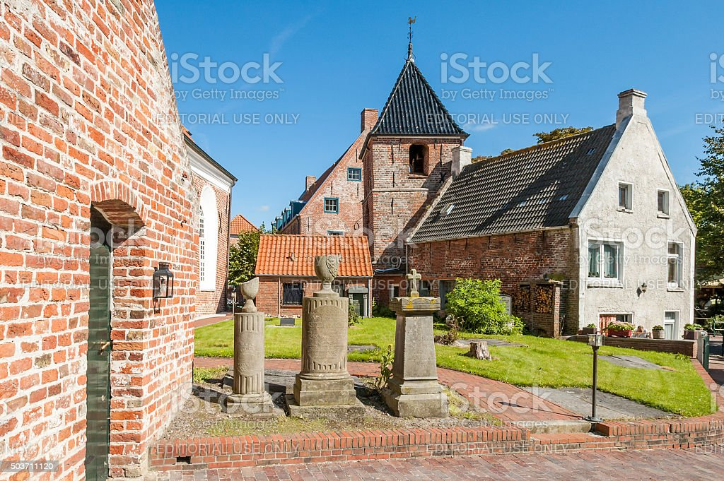 Courtyard of Greetsiel Church, Germany stock photo