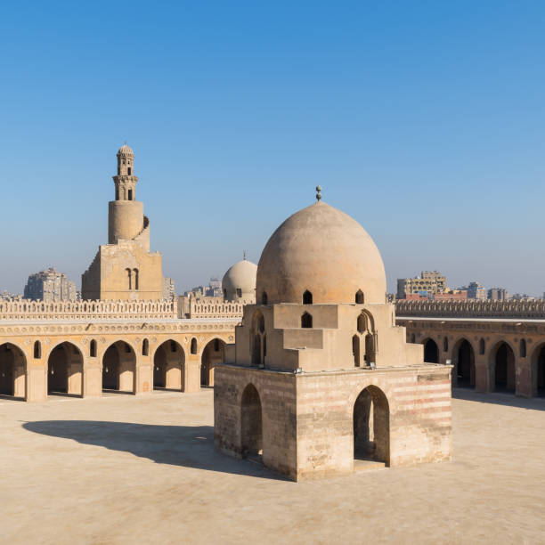 Courtyard of Ibn Tulun public historical mosque with ablution fountain and the minaret, Cairo, Egypt stock photo
