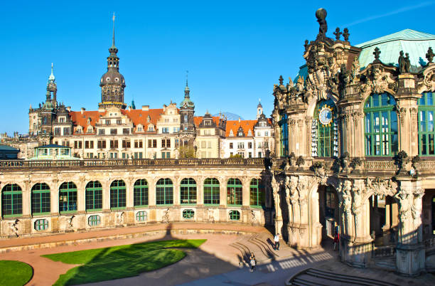 Courtyard of Zwinger gallery, Dresden, Germany. Picturesque Baroque architectural buildings, green arch windows, cut grass. Cloudless spring day. Shot from above Courtyard of Zwinger gallery, Dresden, Germany. Picturesque Baroque architectural buildings, green arch windows, cut grass. Cloudless spring day. Shot from above zwanger stock pictures, royalty-free photos & images