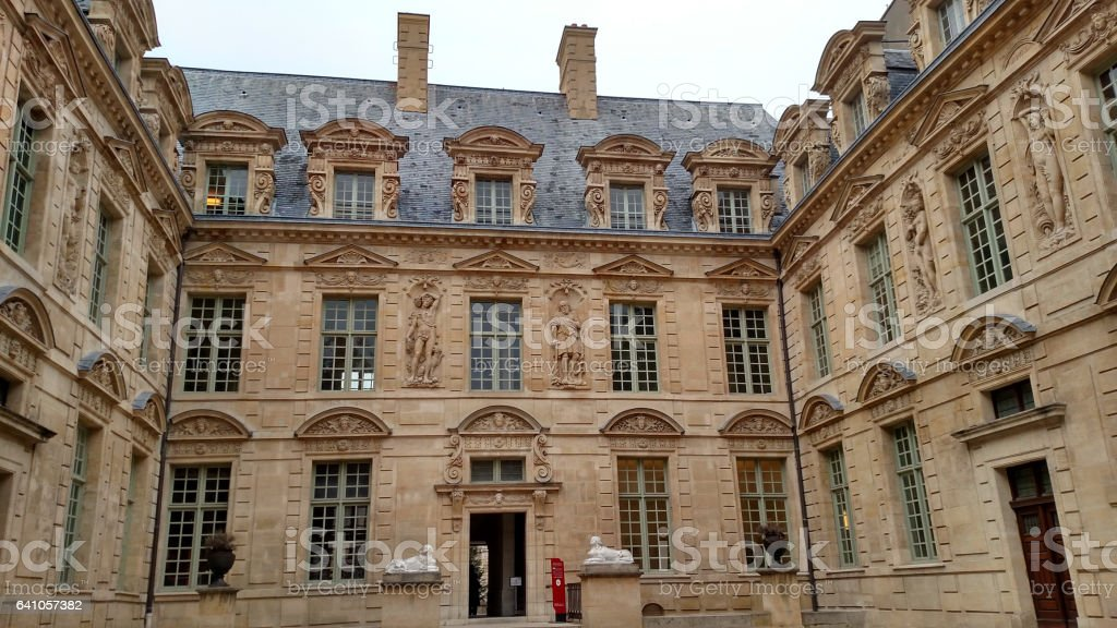 Courtyard passageway Hotel de Sully Louis XIII architecture Paris France stock photo