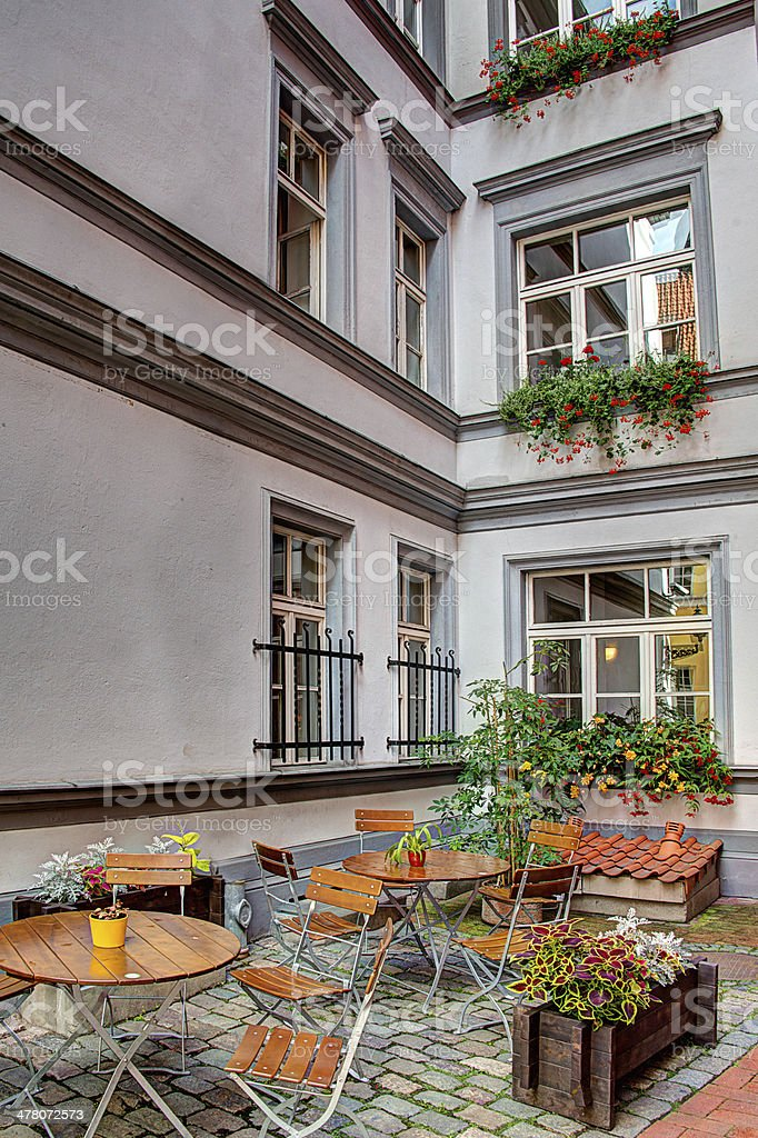 Courtyard Restaurant with cobbled floor in Riga Latvia royalty-free stock photo