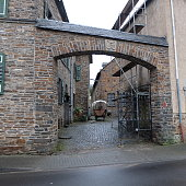 Hatzenport, Rheinland-Palz / Germany - January 6 2018: Romantic get away town stone courtyard with wagon and gate along the Mosel (Moselle) River in Rheinland-Pfalz, Germany.
