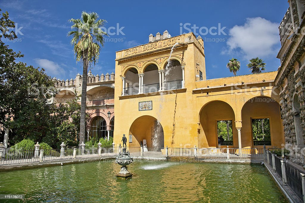 Courtyard with water pool of Alcazar,, Seville,  Spain royalty-free stock photo