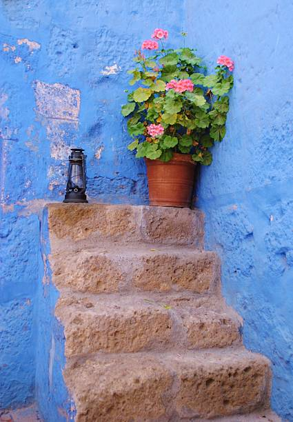Courtyards with Geraniums & Cornflower Blue Walls stock photo