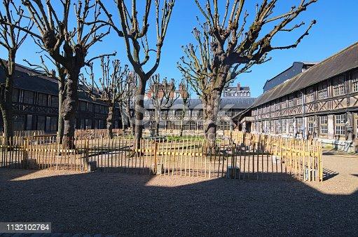 Couryard in Aitre de Saint Maclou in Rouen, ancient graveyard of victims of epidemic. Rouen, Normandy, France.