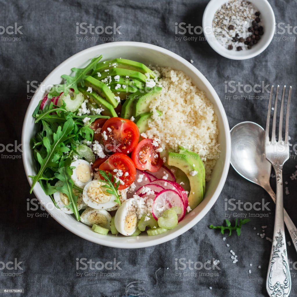 Couscous and vegetables bowl. Healthy, diet, vegetarian food concept. Top view, free space for text stock photo