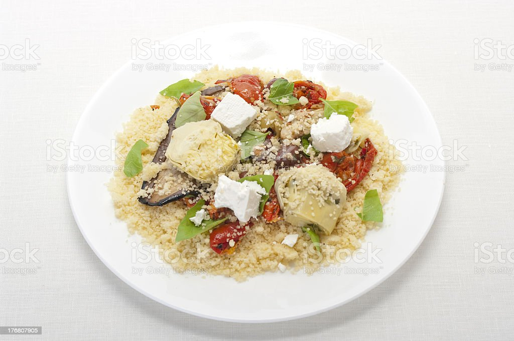 Couscous with antipasto vegetables, fetta cheese and basil royalty-free stock photo