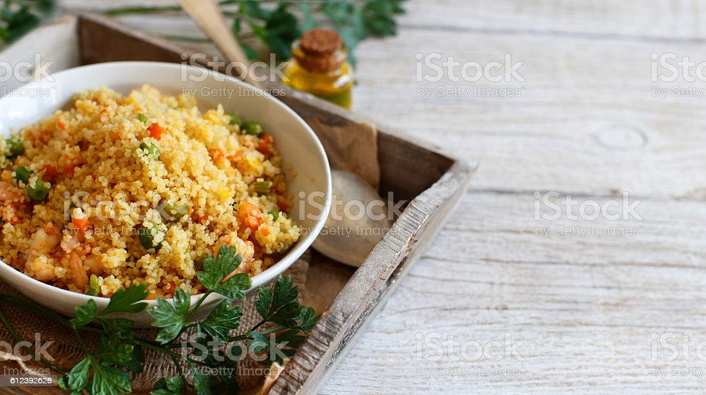 Couscous with shrimps and vegetables stock photo