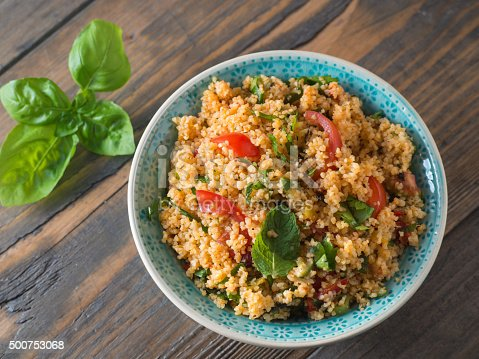 Arabic traditional cuisine - Couscous with tomato and basil from the top