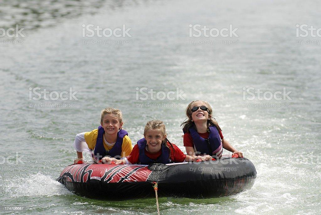 Cousins Tubing on the Lake royalty-free stock photo