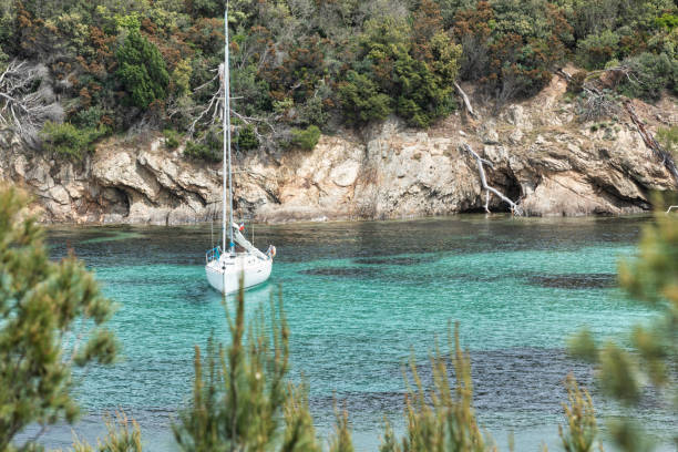 Cove and sailing boat in the island of Porquerolles in the Var, in Provence, on the Côte d'Azur stock photo