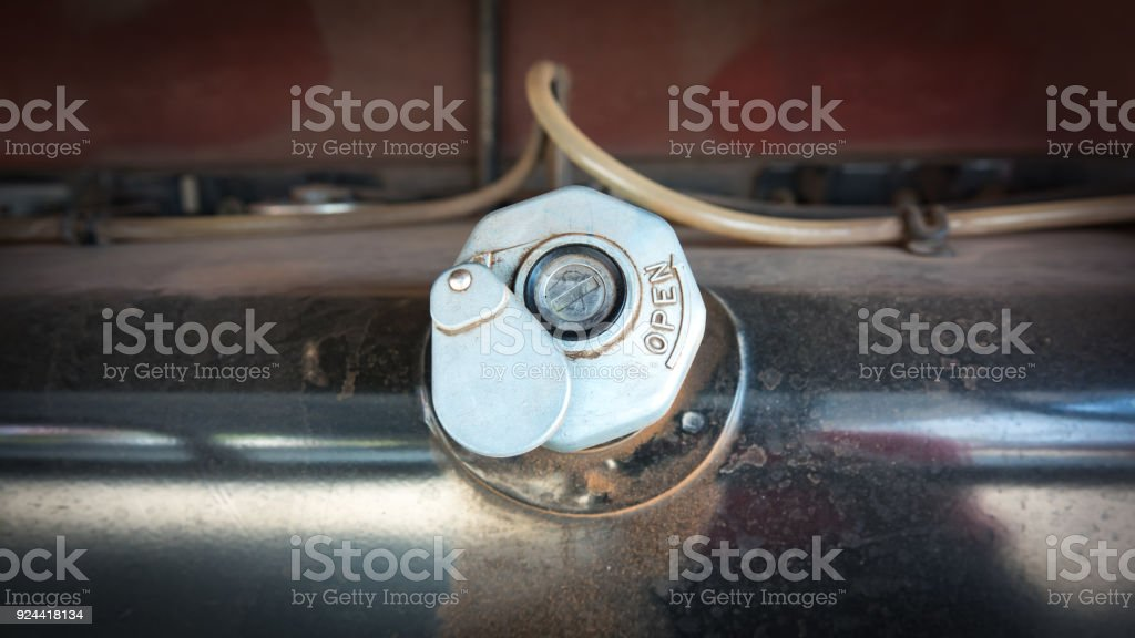 Cover fuel oil tank for machine stock photo
