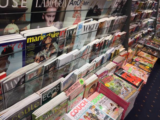 Cover pages of magazines Berlin, Germany - March 15, 2018: newsstand interior, cover pages of German magazines displayed for sale on a stand news stand stock pictures, royalty-free photos & images
