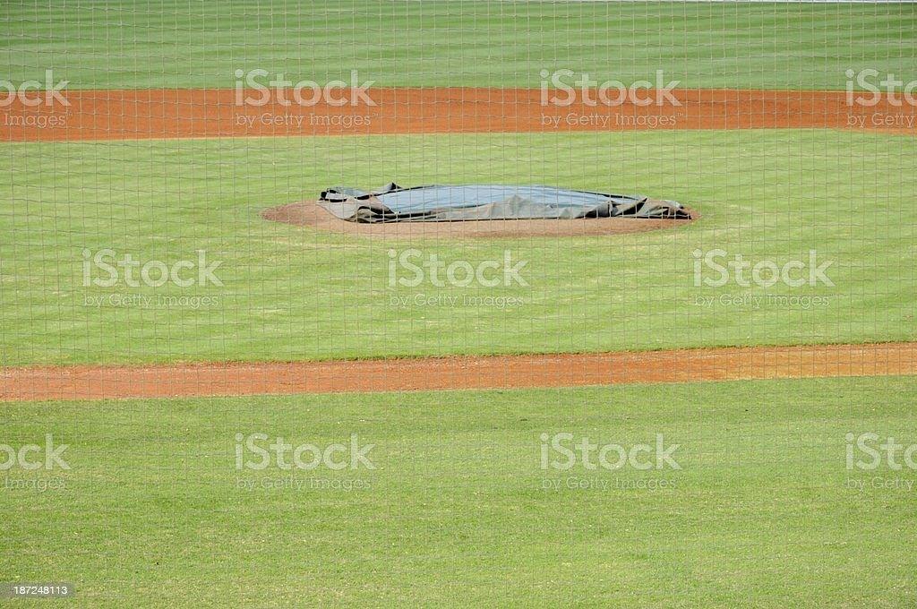 Covered baseball mound in offseason stock photo