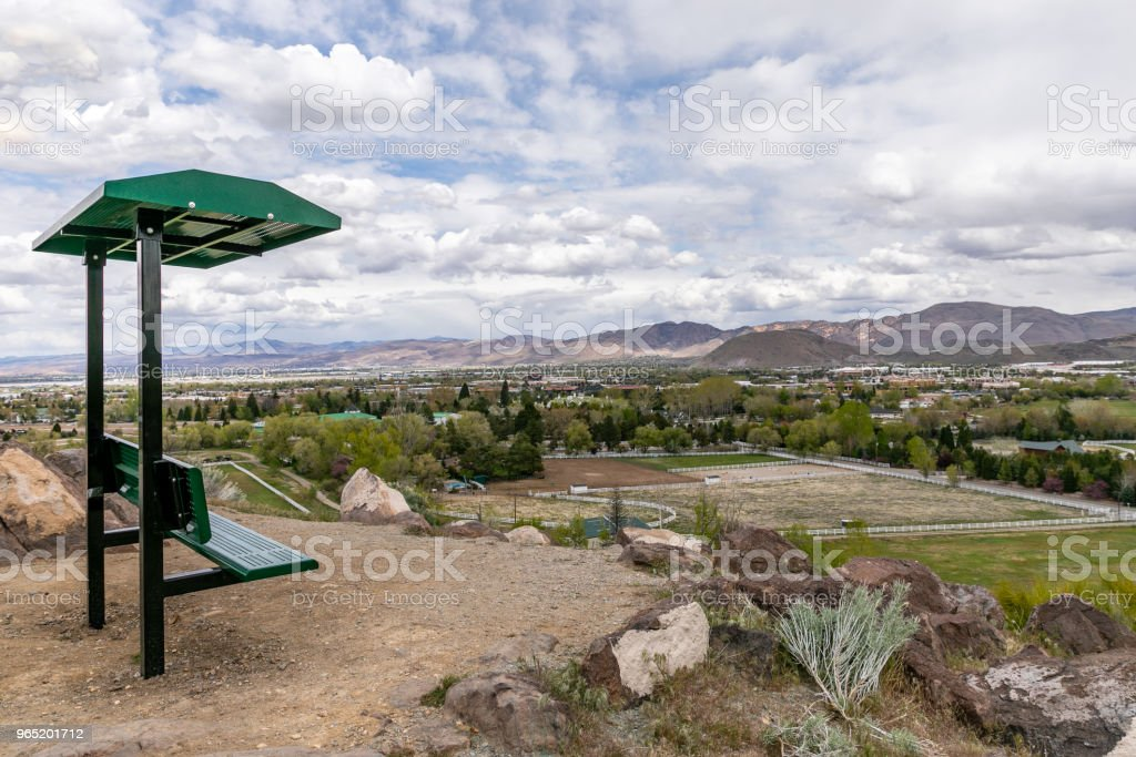 Covered bench with a view of Reno, Nevada looking East. royalty-free stock photo
