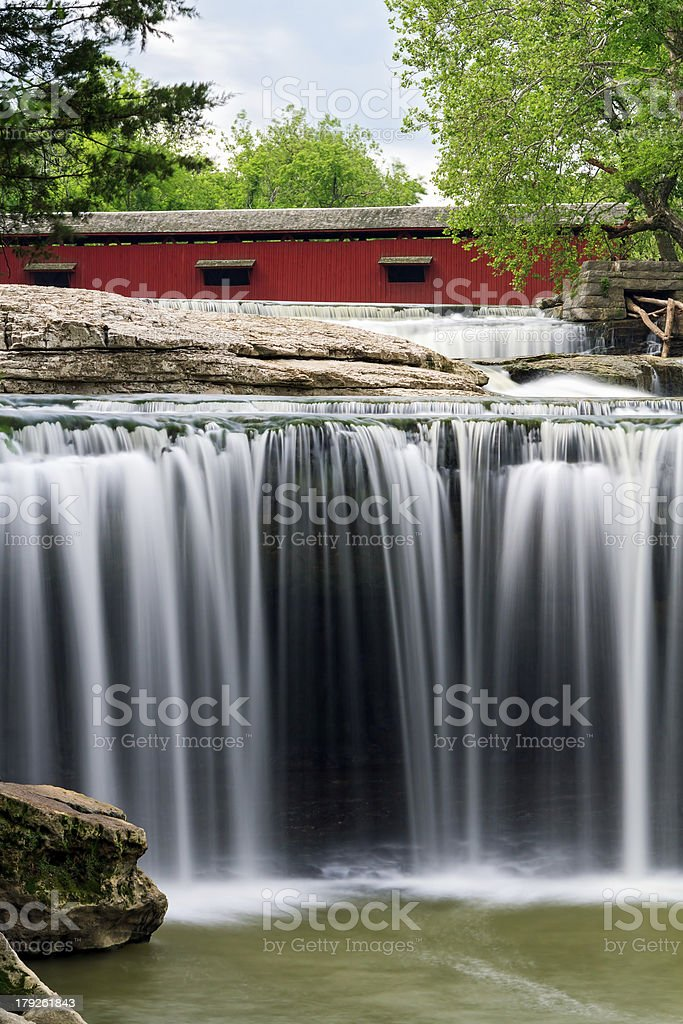Covered Bridge and Waterfall stock photo