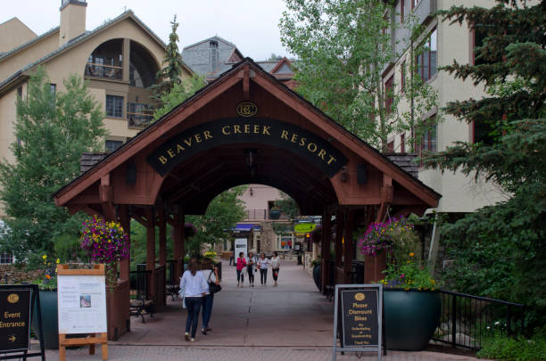 Covered Bridge at Beaver Creek Resort Beaver Creek, United States - July 16, 2013: Covered Bridge at Beaver Creek Resort - The base area at Beaver Creek Resort is designated by a covered bridge, leading to central courtyards, shops and lodges.  In the summer baskets of colorful flowers abound. avon colorado stock pictures, royalty-free photos & images