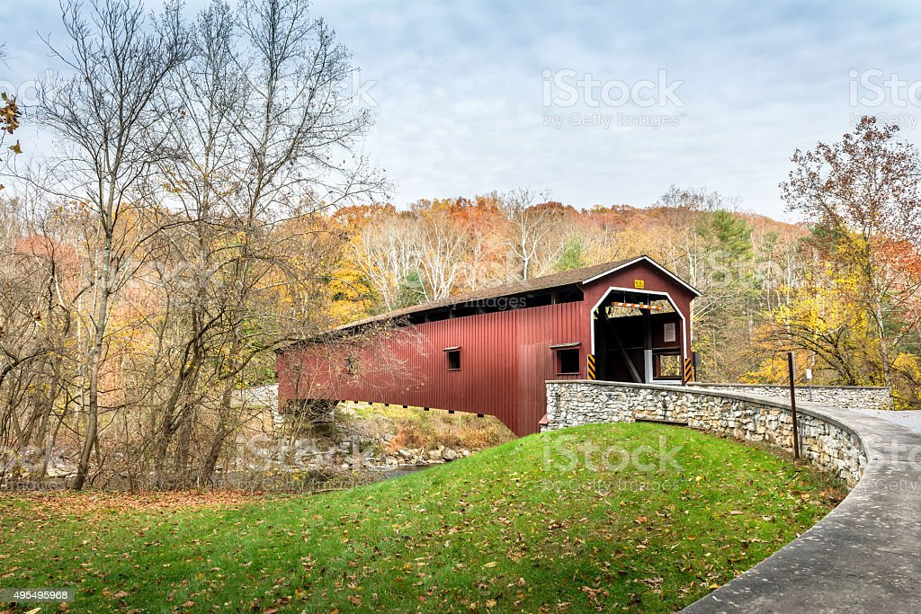 Covered Bridge in Pennsylvania during Autumn stock photo