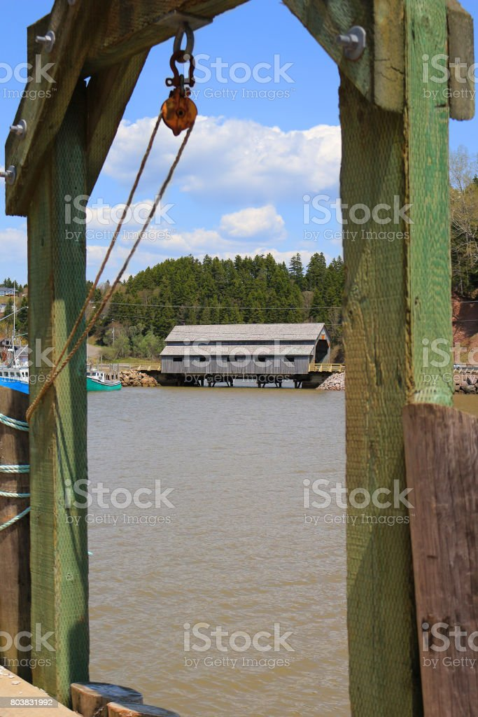 covered Bridge in St. Martins, New Brunswick during High Tide on the Bay of Fundy, Canada stock photo