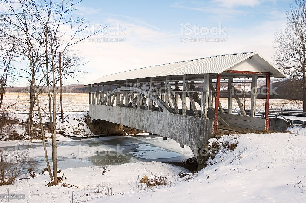 Covered Bridge in Winter Landscape stock photo