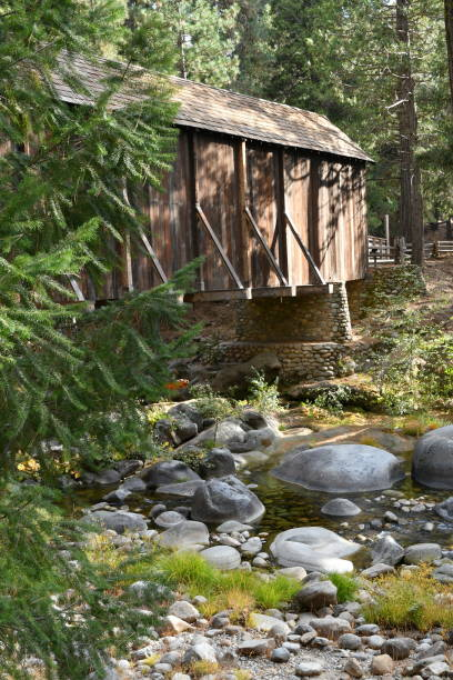 covered bridge over rock filled river - steven harrie stock pictures, royalty-free photos & images
