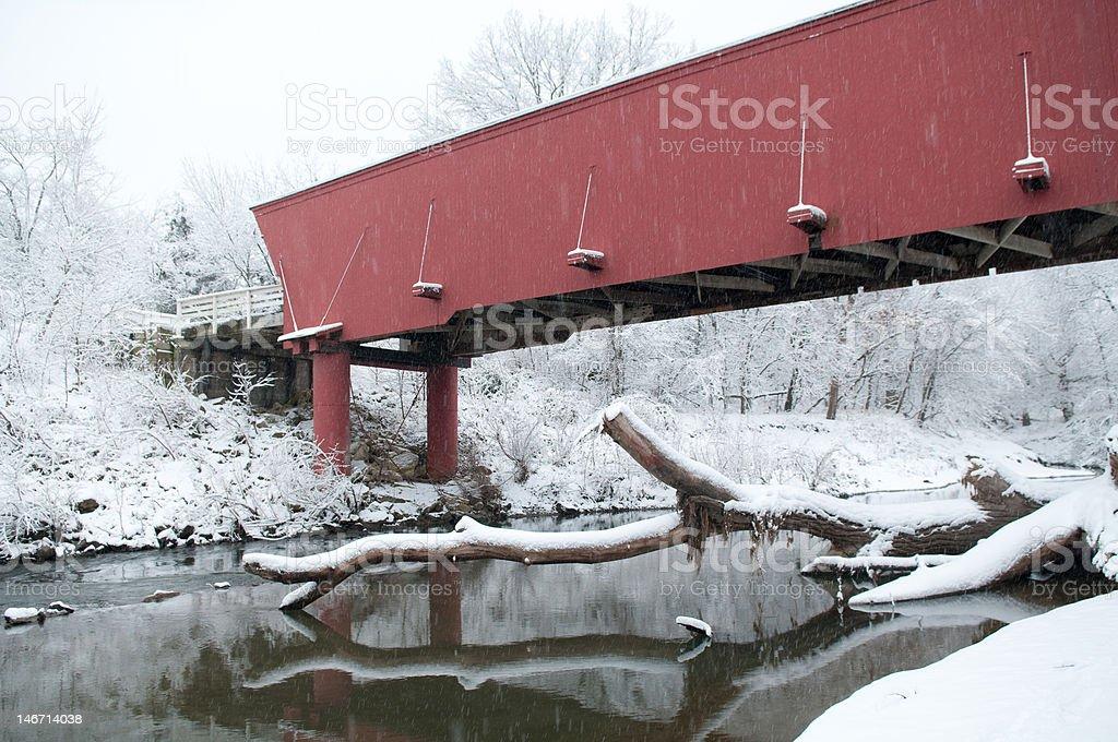 Covered Bridge over Winter stream royalty-free stock photo