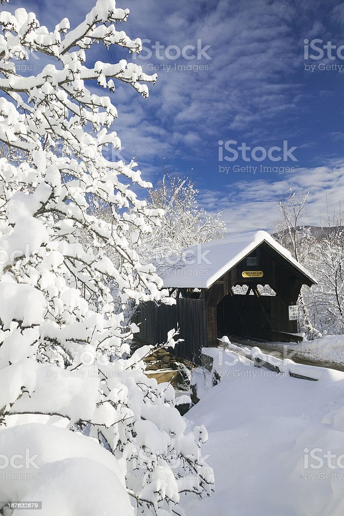 Covered bridged blanketed in fresh snow. stock photo